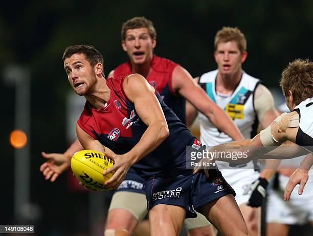Jeremy Howe of the Demons looks to handball during the round 17 AFL match between the Melbourne Demons and Port Adelaide Power at TIO Stadium on July...