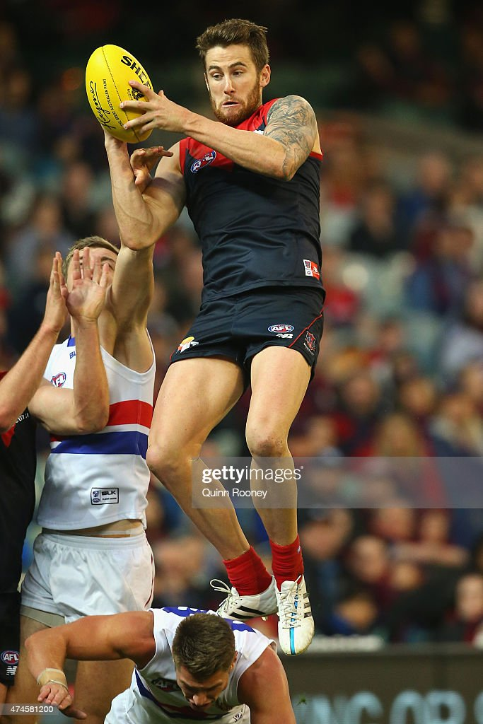Jeremy Howe of the Demons marks over the top of Michael Talia of the Bulldogs during the round eight AFL match between the Melbourne Demons and the Western Bulldogs at Melbourne Cricket Ground on May 24, 2015 in Melbourne, Australia.