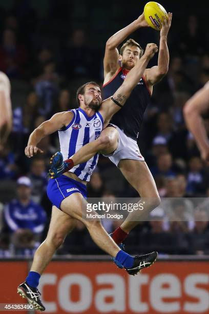 Jeremy Howe of the Demons marks the ball against Ben Cunnington of the Kangaroos during the round 23 AFL match between the North Melbourne Kangaroos...
