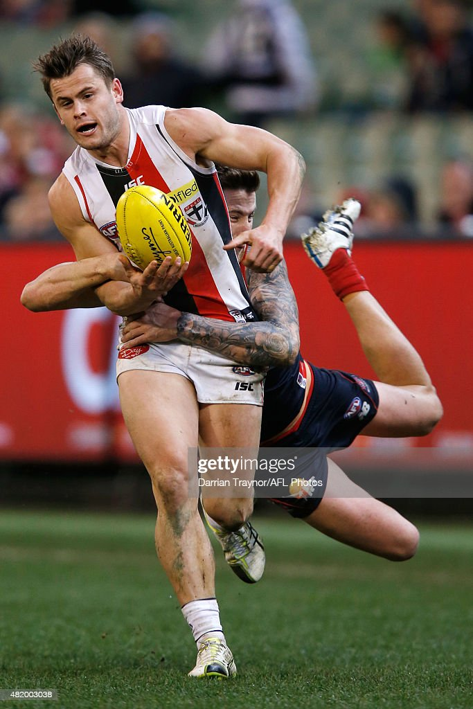 Jeremy Howe of the Demons tackles Maverick Weller of the Saints during the round 17 AFL match between the Melbourne Demons and the St Kilda Saints at Melbourne Cricket Ground on July 26, 2015 in Melbourne, Australia.