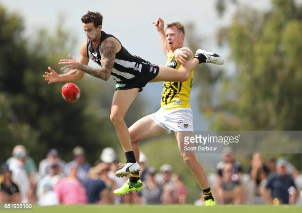 Jeremy Howe of the Magpies and Jack Riewoldt of the Tigers compete for the ball during the 2017 JLT Community Series AFL match between the Richmond...