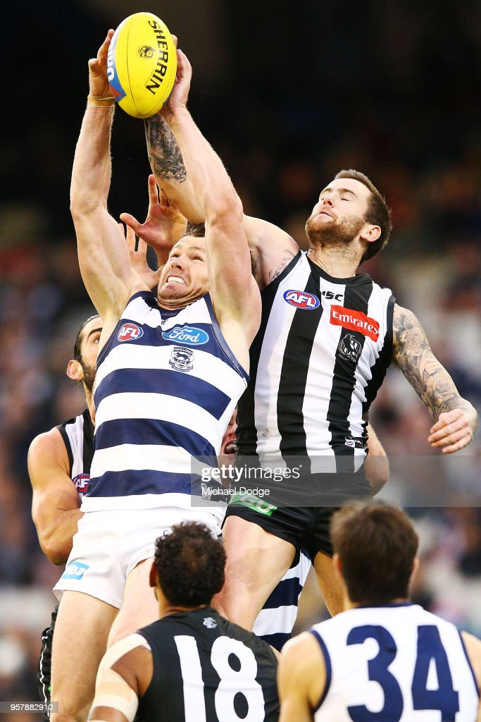 Jeremy Howe of the Magpies (R) and Patrick Dangerfield of the Cats compete for the ball during the round eight AFL match between the Collingwood Magpies and the Geelong Cats at Melbourne Cricket Ground on May 13, 2018 in Melbourne, Australia.