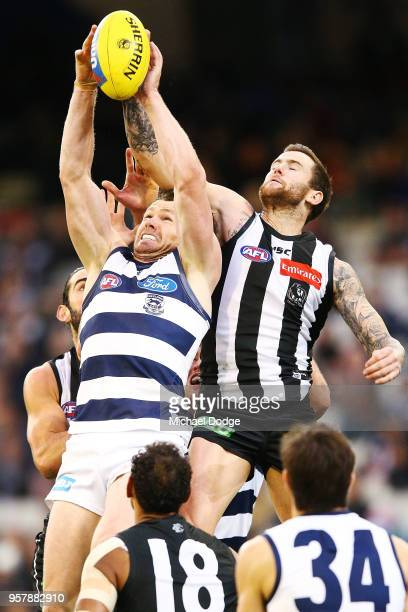 Jeremy Howe of the Magpies and Patrick Dangerfield of the Cats compete for the ball during the round eight AFL match between the Collingwood Magpies...