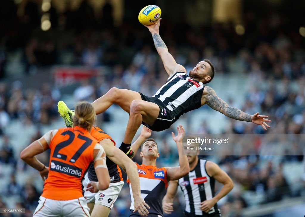 Jeremy Howe of the Magpies attempts to take a spectacular mark during the round two AFL match between the Collingwood Magpies and the Greater Western Sydney Giants at Melbourne Cricket Ground on March 31, 2018 in Melbourne, Australia.