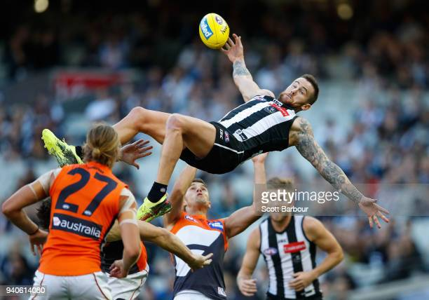Jeremy Howe of the Magpies attempts to take a spectacular mark during the round two AFL match between the Collingwood Magpies and the Greater Western...
