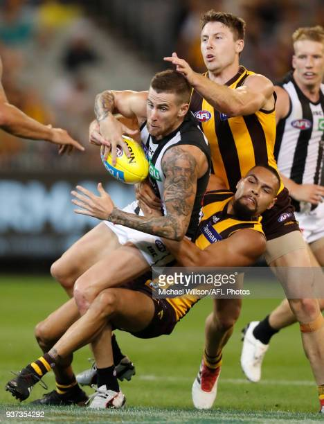 Jeremy Howe of the Magpies is tackled by Jarman Impey of the Hawks during the 2018 AFL round 01 match between the Hawthorn Hawks and the Collingwood...