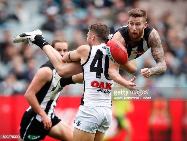 Jeremy Howe of the Magpies is tackled by Sam Gray of the Power during the 2017 AFL round 14 match between the Collingwood Magpies and the Port...