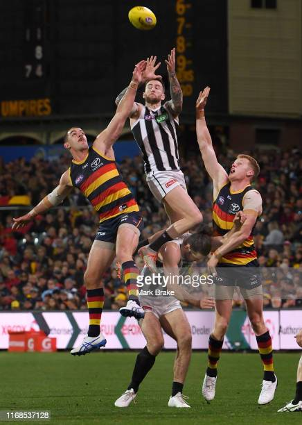 Jeremy Howe of the Magpies marks over Brodie Grundy of the Magpies between Taylor Walker of the Adelaide Crows and Reilly O'Brien of the Adelaide...
