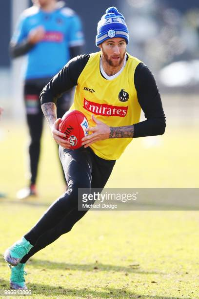 Jeremy Howe of the Magpies runs with the ball during a Collingwood Magpies AFL training session at the Holden Centre on July 12 2018 in Melbourne...