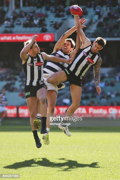 Jeremy Howe of the Magpies spoils Daniel Menzel of the Cats during the round 22 AFL match between the Collingwood Magpies and the Geelong Cats at...