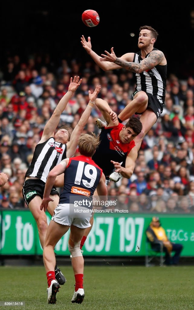 Jeremy Howe of the Magpies takes a spectacular mark over Christian Petracca of the Demons during the 2017 AFL round 23 match between the Collingwood Magpies and the Melbourne Demons at the Melbourne Cricket Ground on August 26, 2017 in Melbourne, Australia.