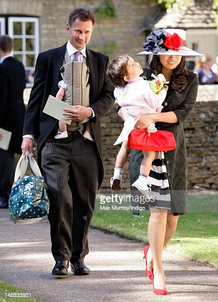 Jeremy Hunt and Lucia Hunt attend the wedding of Henry Allsopp and Naomi Gummer at The Church of St Nicholas Chadlington on May 26 2012 in Chipping...