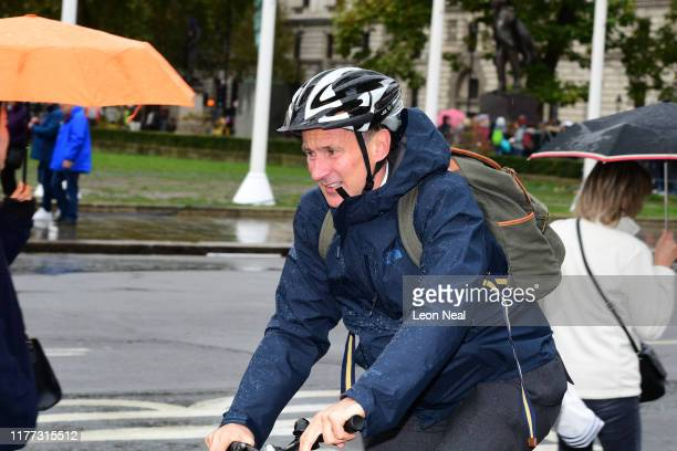 Jeremy Hunt MP arrives at carriage gate entrance for the Houses of Parliament in Westminster on his bicycle on October 21, 2019 in London, England....