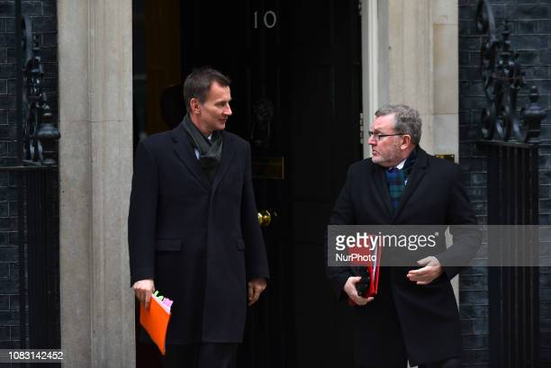 Jeremy Hunt UK foreign secretary and David Mundell UK Scottish secretary depart following a weekly meeting of cabinet ministers at number 10 Downing...