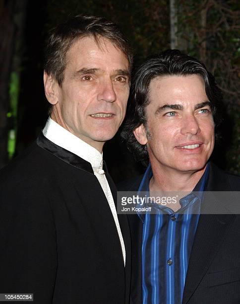 Jeremy Irons and Peter Gallagher during 2005 Vanity Fair Oscar Party at Mortons in Los Angeles California United States