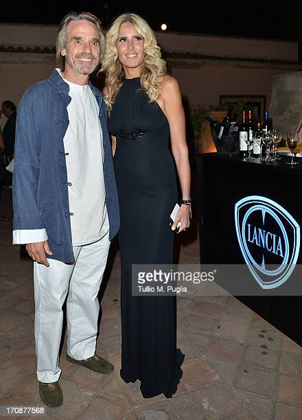 Jeremy Irons and Tiziana Rocca attend the Lancia Cafe during the Taormina Filmfest 2013 on June 19 2013 in Taormina Italy