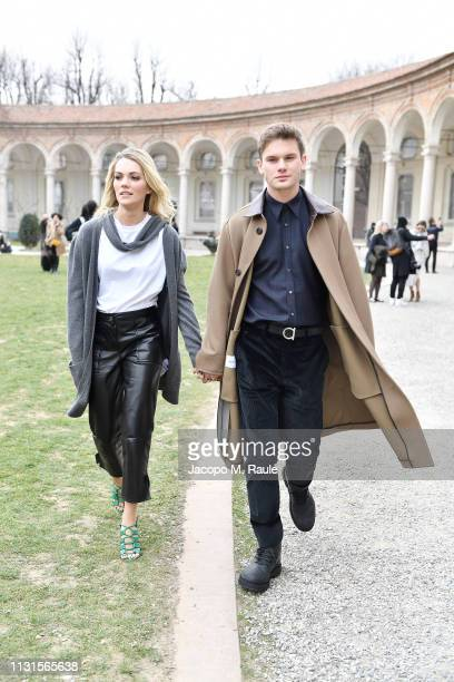 Jeremy Irvine and Jodie Spencer attend the Salvatore Ferragamo show during Milan Fashion Week Autumn/Winter 2019/20 on February 23 2019 in Milan Italy