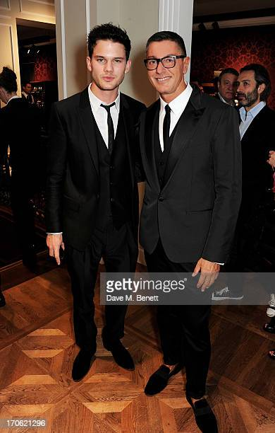 Jeremy Irvine and Stefano Gabbana attend the opening of the new Dolce Gabbana men's store with a preview of the Summer 2014 Tailoring Collection at...