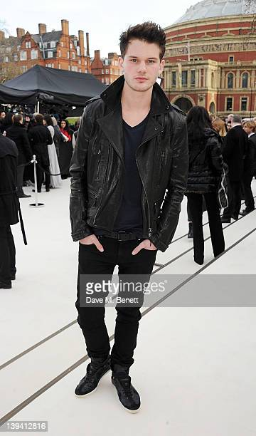 Jeremy Irvine arrives at the Burberry Autumn Winter 2012 Womenswear Show during London Fashion Week at Kensington Gardens on February 20 2012 in...