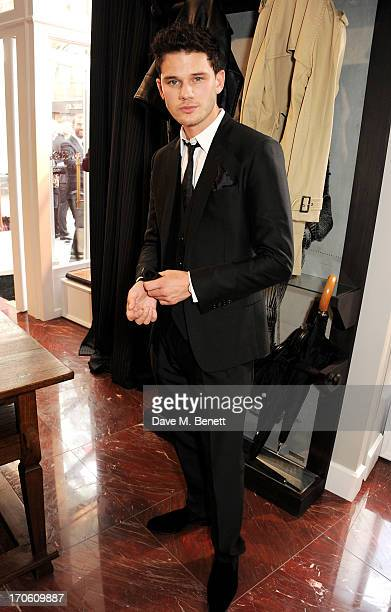 Jeremy Irvine attends the opening of the new Dolce Gabbana men's store with a preview of the Summer 2014 Tailoring Collection at Dolce Gabbana on...