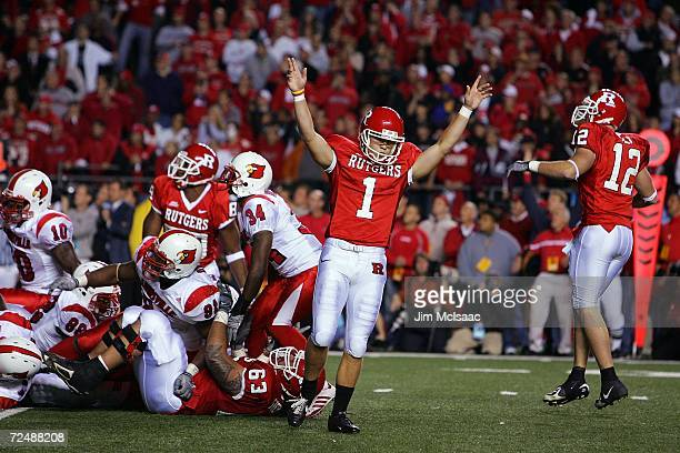 Jeremy Ito of the Rutgers Scarlet Knights celebrates after kicking the game winning field goal against the Louisville Cardinals at Rutgers Stadium on...