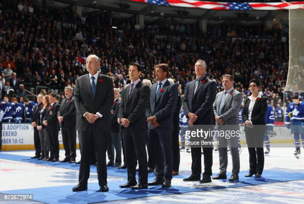 Jeremy Jacobs Paul Kariya Teemu Selanne Dave Andreychuk Mark Recchi and Danielle Goyotte take part in the pregame ceremony prior to the game between...