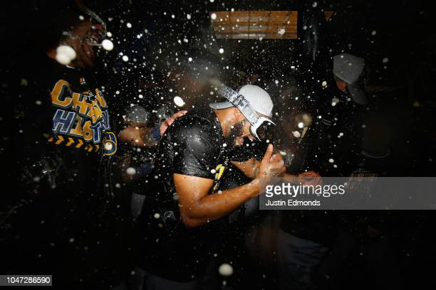 Jeremy Jeffress of the Milwaukee Brewers celebrates with teammates in the locker room after they won Game Three to clinch the National League...