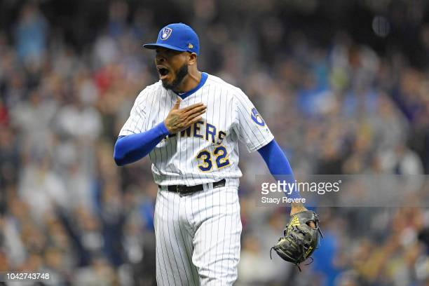 Jeremy Jeffress of the Milwaukee Brewers reacts to a double play during the ninth inning of a game against the Detroit Tigers at Miller Park on...