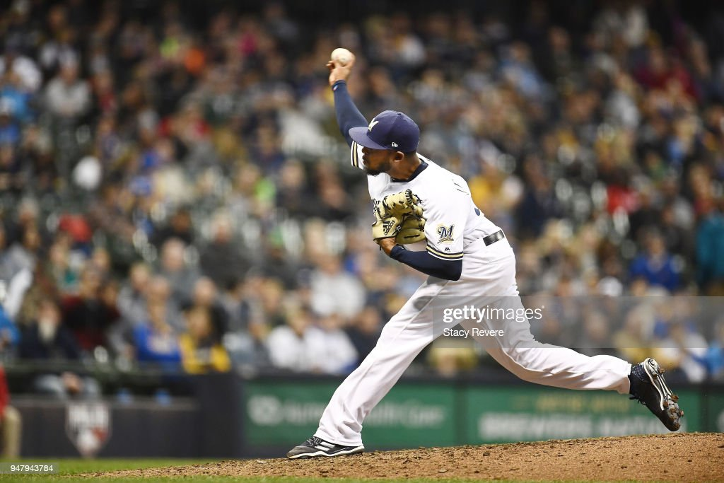 Jeremy Jeffress #32 of the Milwaukee Brewers throws a pitch during the seventh inning of a game against the Cincinnati Reds at Miller Park on April 17, 2018 in Milwaukee, Wisconsin.