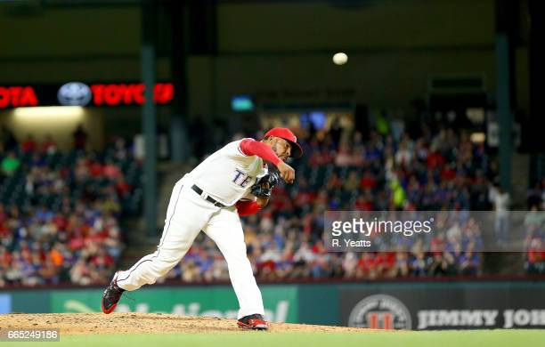Jeremy Jeffress of the Texas Rangers throws in the seventh inning against the Cleveland Indians at Globe Life Park in Arlington on April 4 2017 in...