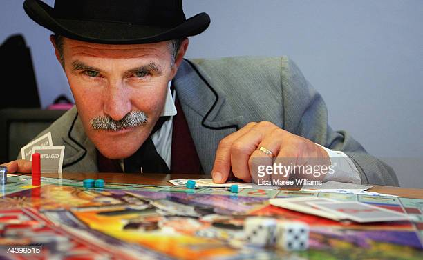 Jeremy Johnson from Sovereign Hill Museums plays the new look Australian Here and Now Monopoly board at Hasbro's Head Office on June 5 2007 in Sydney...