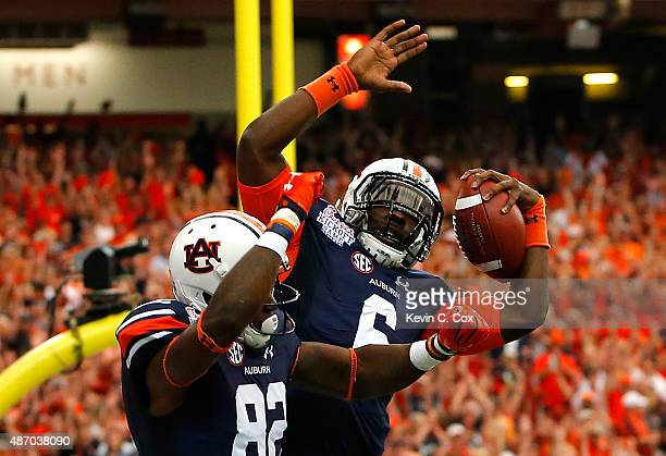 Jeremy Johnson of the Auburn Tigers reacts after scoring a touchdown against the Louisville Cardinals with Melvin Ray at Georgia Dome on September 5...