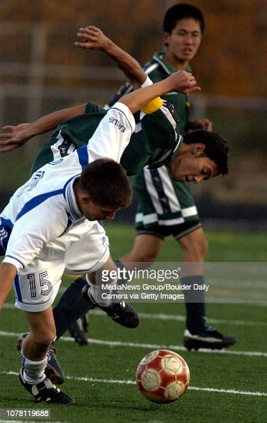 Jeremy Jonsen Broomfield High School left collides with Pueblo County High School's Fidencio AgustinSelgado Tuesday during the first round of playoff...