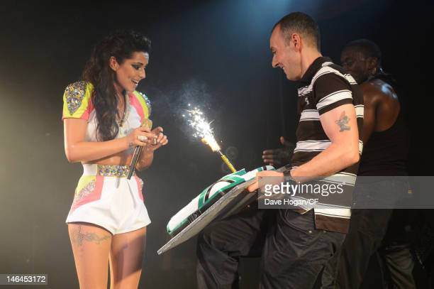 Jeremy Joseph presents Cheryl Cole with a cake as she performs songs from her new album 'A Million Lights' at GAY on 16 June 2012 in London England