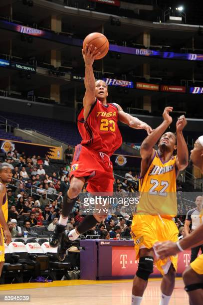 Jeremy Kelly of the Tulsa 66ers goes up for a layup against Marcus White of the Los Angeles DFenders at Staples Center on December 7 2008 in Los...