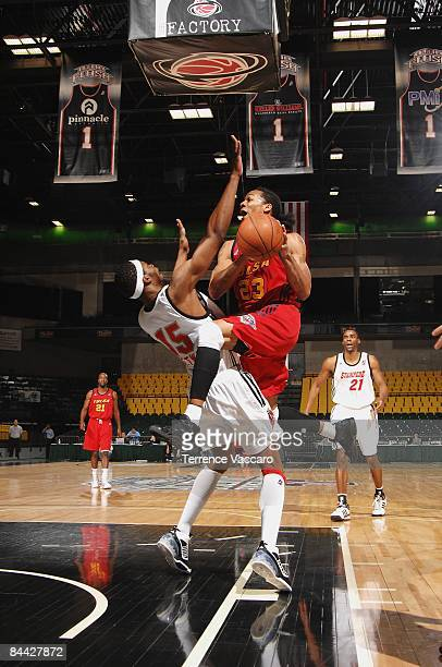 Jeremy Kelly of the Tusla 66ers takes the ball to the basket against Brent Petway of the Idaho Stampede at McKay Events Center during the NBA DLeague...