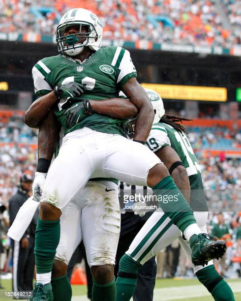 Jeremy Kerley is lifted in the air by Bilal Powell of the New York Jets after scoring a fourth quarter touchdown against the Miami Dolphins on...