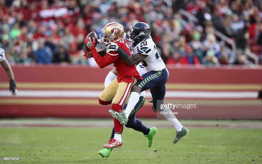 Jeremy Kerley #17 of the San Francisco 49ers catches the ball while covered by Jeremy Lane #20 of the Seattle Seahawks at Levi's Stadium on January 1, 2017 in Santa Clara, California.