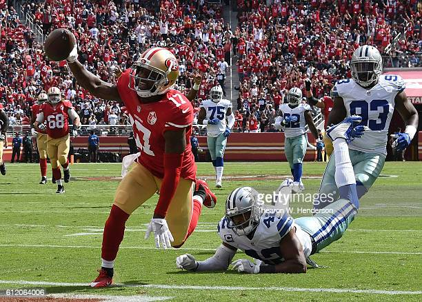 Jeremy Kerley of the San Francisco 49ers crosses the goal line for a touchdown after catching a pass against the Dallas Cowboys at Levi's Stadium on...
