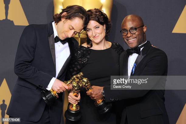 Jeremy Kleiner Adele Romanski and Barry Jenkins attend the 89th Annual Academy Awards Press Room at Hollywood Highland Center on February 26 2017 in...