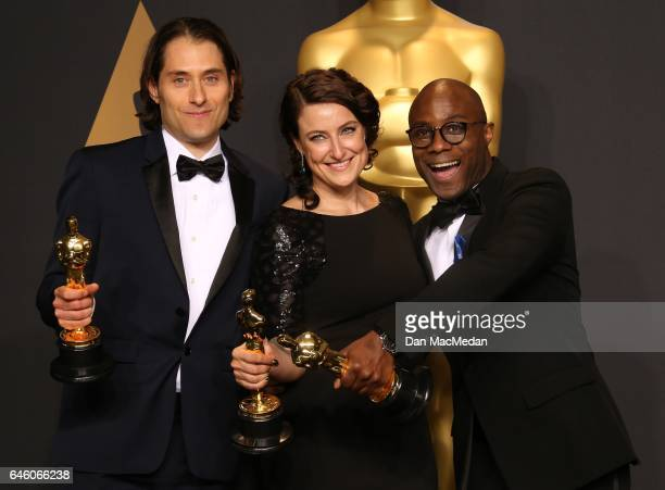Jeremy Kleiner Adele Romanski and Barry Jenkins pose in the press room with award for Best Picture for 'Moonlight' at the 89th Annual Academy Awards...