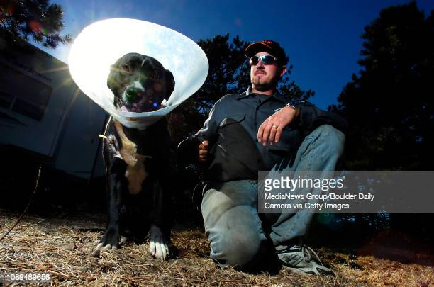 Jeremy Kocar from Wisconsin sits with eightmonthold Duke who what mauled by a mountain lion by their campertrailer near Gross Reservoir early Friday...