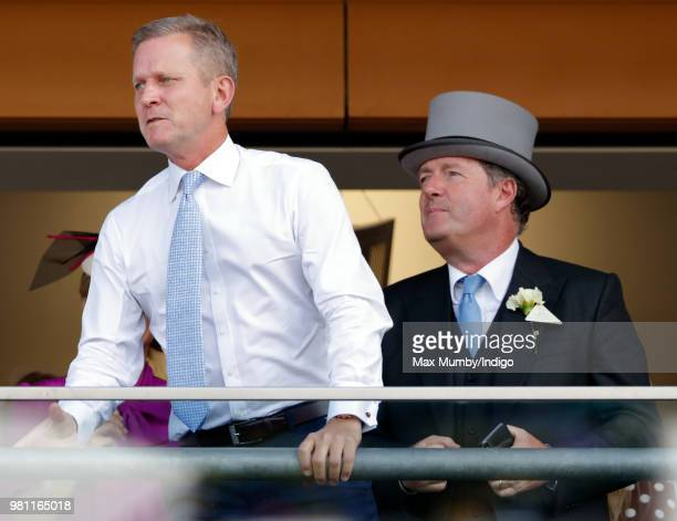 Jeremy Kyle and Piers Morgan watch the racing on day 2 of Royal Ascot at Ascot Racecourse on June 20 2018 in Ascot England
