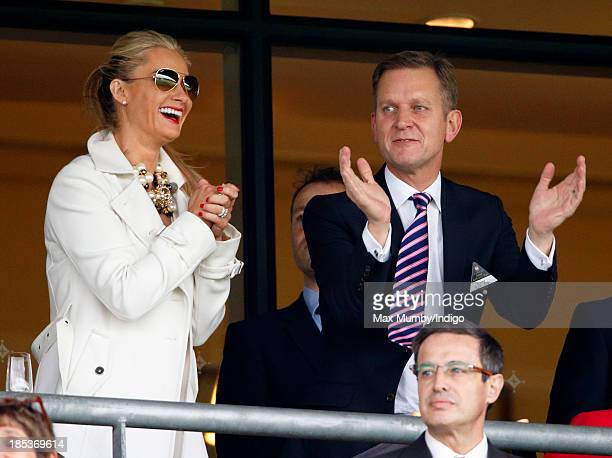 Jeremy Kyle and wife Carla Kyle cheer whilst watching the racing as they attend the QIPCO British Champions Day at Ascot Racecourse on October 19...