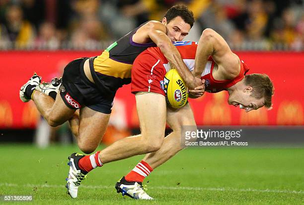 Jeremy Laidler of the Swans is tackled by Shane Edwards of the Tigers during the round eight AFL match between the Richmond Tigers and the Sydney...