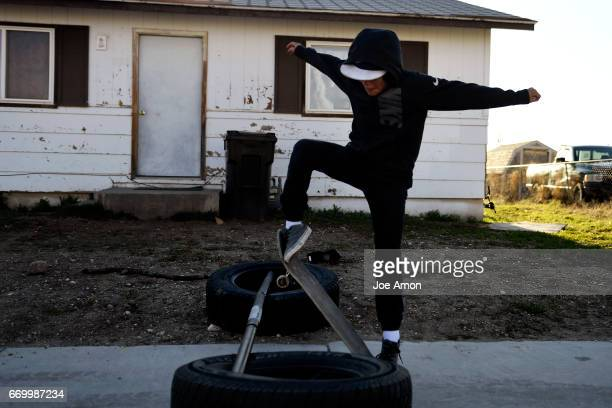 Jeremy Lakey 12 working to jump his skateboard in front of his home in Ethete on the Wind River Indian Reservation Jeremy is learning the Arapaho...