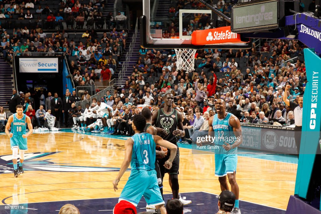 Jeremy Lamb #3, Michael Carter-Williams #10 and Dwight Howard #12 of the Charlotte Hornets react during game against the Milwaukee Bucks on December 23, 2017 at the Spectrum Center in Charlotte, North Carolina.