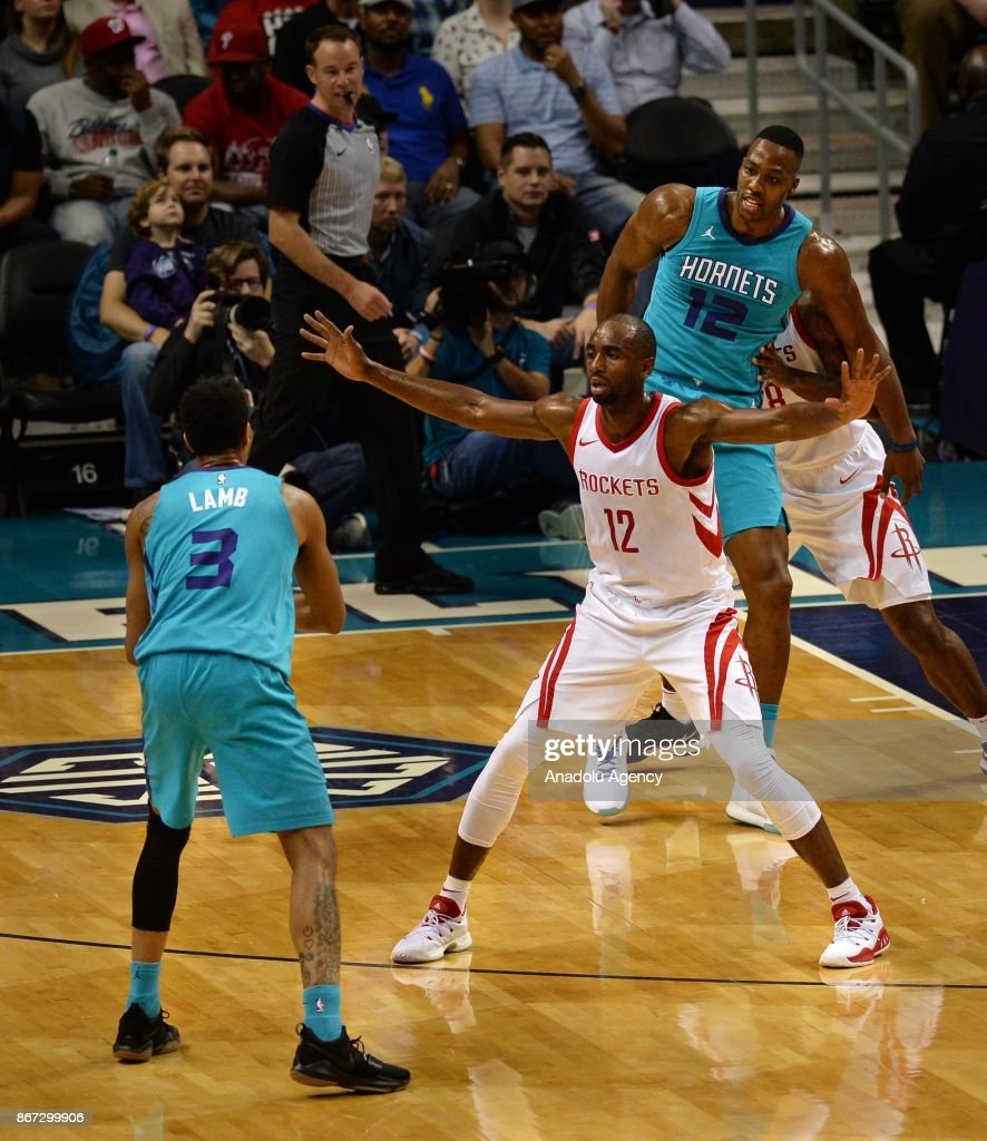 Jeremy Lamb of Charlotte Hornets is blocked by Luc Mbah a Moute of Houston Rockets during the NBA match between Houston Rockets vs Charlotte Hornets at the Spectrum arena in Charlotte, NC, United States on October 27, 2017