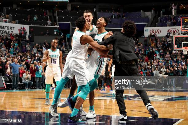 Jeremy Lamb of the Charlotte Hornets celebrates with his teammates after the game against the Detroit Pistons on December 12 2018 at Spectrum Center...