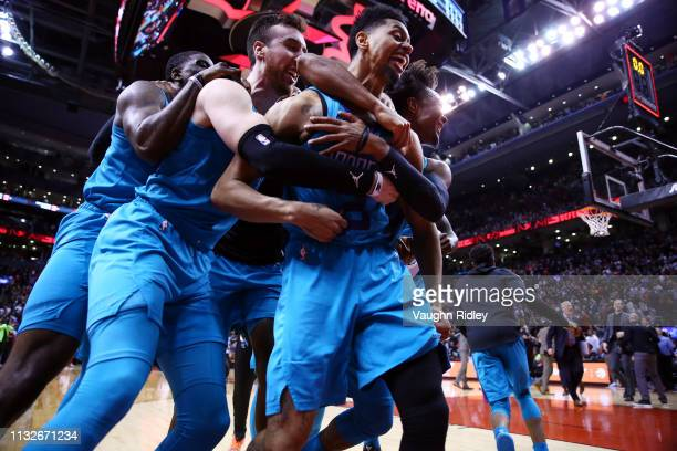 Jeremy Lamb of the Charlotte Hornets celebrates with teammates after sinking a buzzer beater to win an NBA game against the Toronto Raptors at...